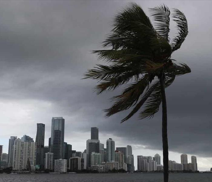 Storm clouds are seen over Miami as Hurricane Isaias approaches the east coast of Florida on Saturday. Photograph: Joe Raedle